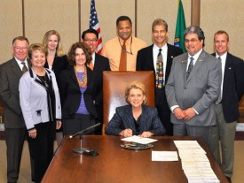 Governor Gregoire signing Moscoso's bill, HB 1384 on May 3, 2011