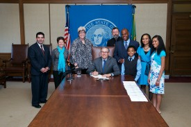 Governor Inslee signs House Bill No. 1821 relating to good cause exceptions during permanency hearings. Rep. Roger Freeman.