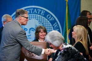 Governor Inslee with Rep. Tarleton (center) and Dana Widrig (right). Dana's story was the inspiration behind HB 1647.