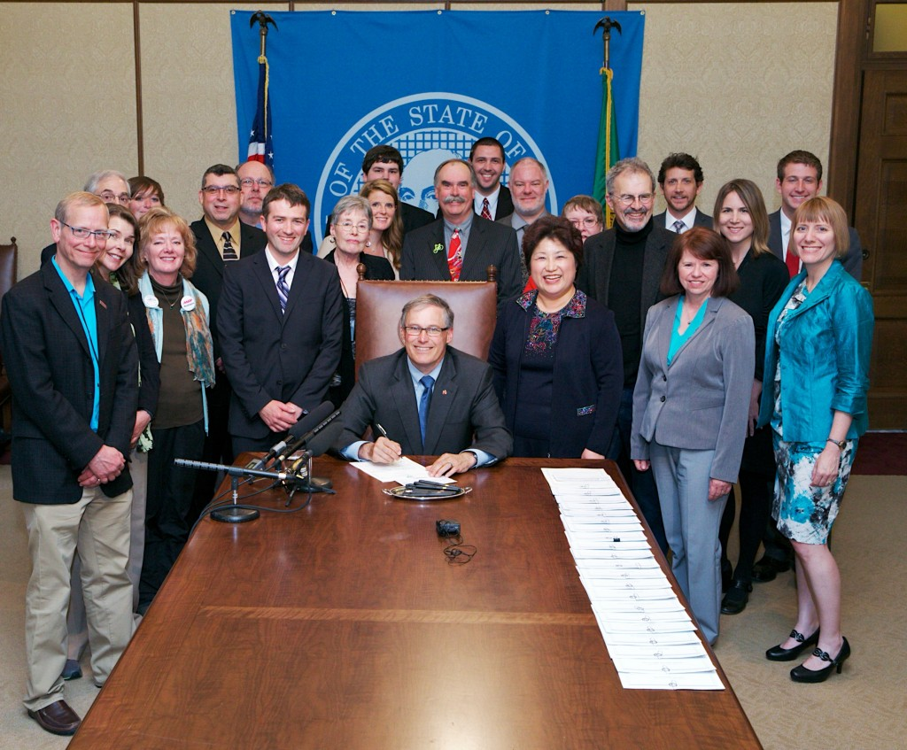 Gov. Jay Inslee signs the Neighborhood Safe Streets Act (House Bill 1045) by Rep. Cindy Ryu (D-Shoreline).