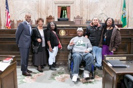 Rep. Freeman with Dom Cooks, Federal Way high school student, football player and hero, and family.