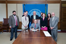 Rep. Springer at his bill signing with Gov Inslee and advocates