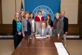 Rep. Jinkins at bill signing with Gov Inslee