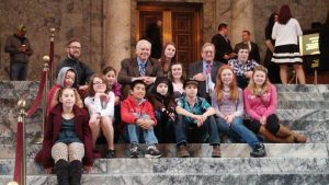 Boys and Girls Club members with Rep. Kevin Van De Wege inside the state capitol.