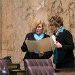 Rep. Wylie discussing legislation with Rep. Liz Pike on first day of Session