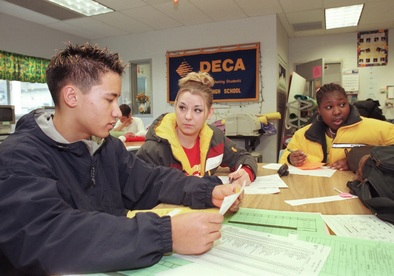 students sitting at table in school1