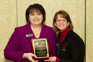 "Olympia High School counselor Kim Reykdal presenting Marcie with the WSCA ""Legislative Advocate of the Year"" award."