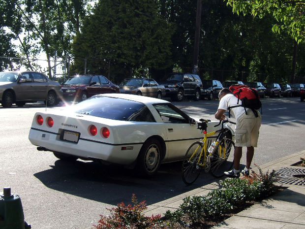 corvette asking bicyclist for directions