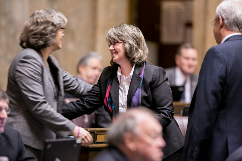 Rep. Tarleton is congratulated by fellow lawmakers after passing her first bill, HB 1647, from the House of Representatives. HB 1647 would require landlords to safely secure spare keys to rental units.