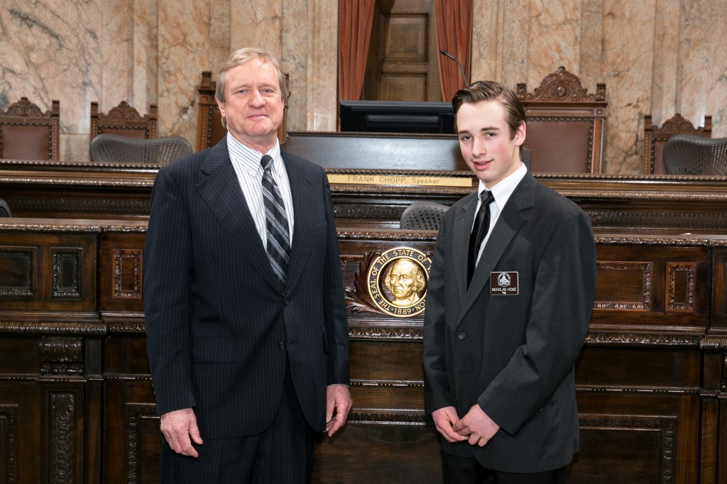 Representative Tharinger with Page Nicholas Howe Steven M. Herppich