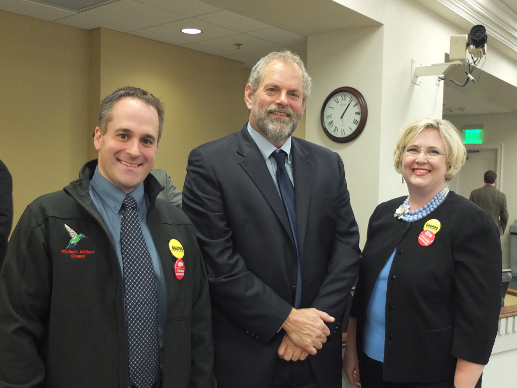 Rep. Hans Dunshee (D-Snohomish) Everett teacher Jared Kink (left) and Franklin Pierce teacher Pam Kruse, who both spoke in support of a $700 million plan to build elementary schools.