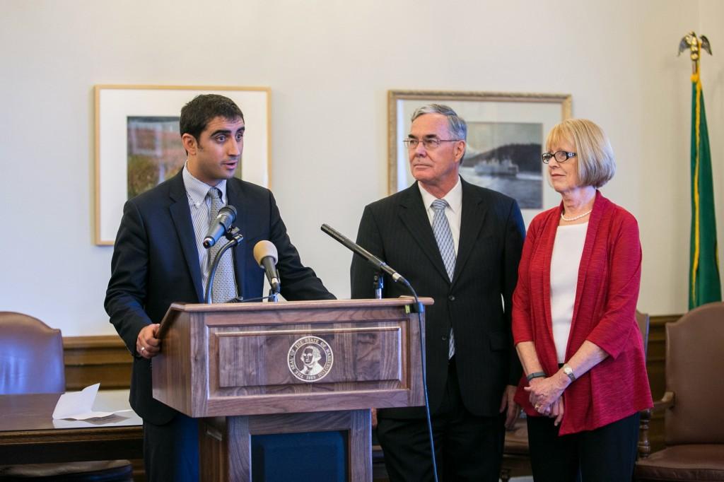 Rep. Brady Walkinshaw, sponsor of Joel's Law, standing with Joel's parents, Doug and Nancy Reuter