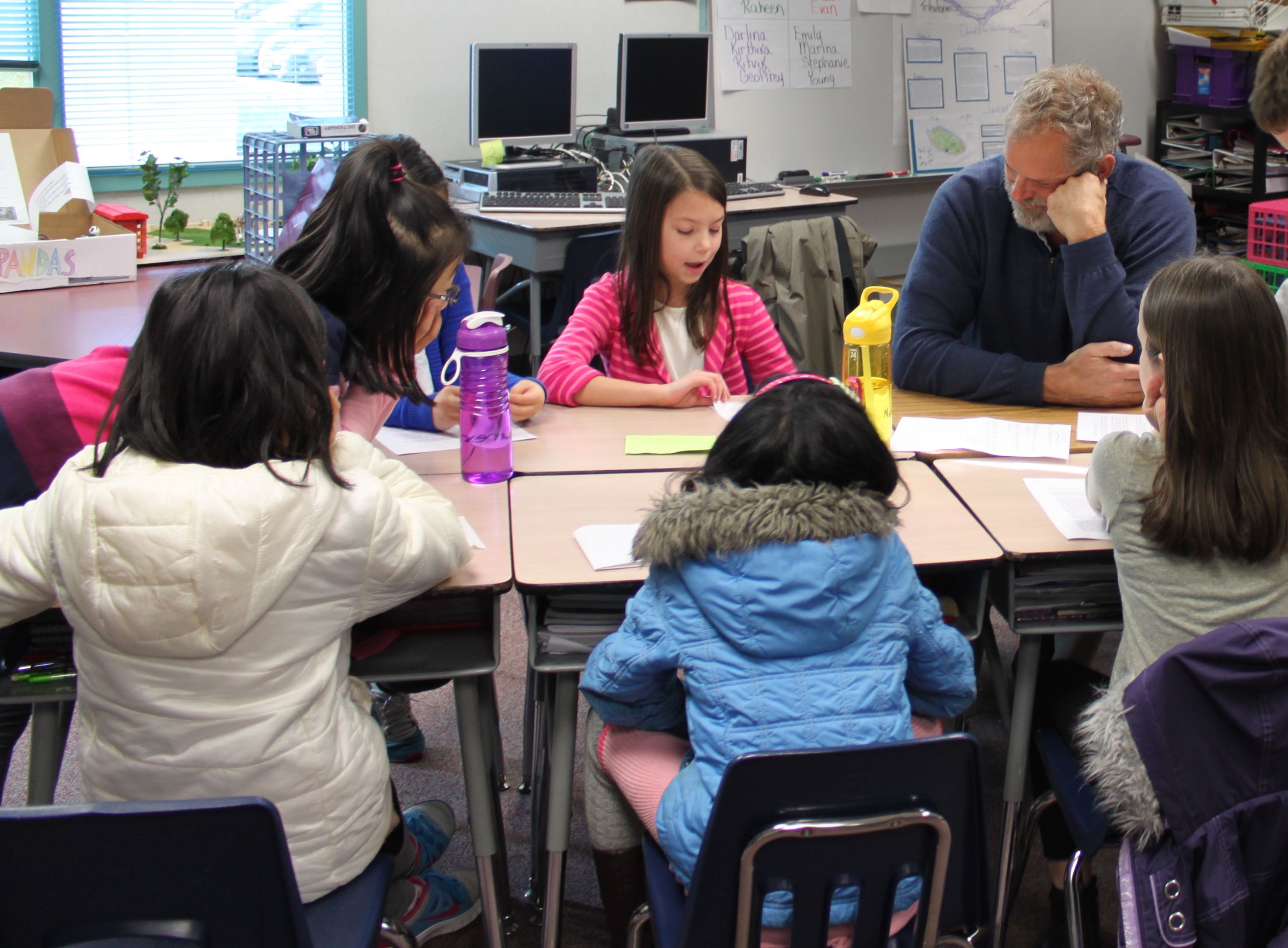Students at Cedar Wood Elementary give their opinion on issues to Rep. Hans Dunshee. Photo by teacher Barbara Tibbits.