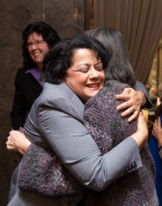 Reps. Lillian Ortiz-Self and Sharon Tomiko Santos embrace after HB 1541 wins approval in the Senate.