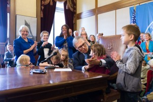 Governor Jay Inslee signs the executive order.