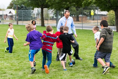 Rep. Riccelli playing soccer with schoolkids