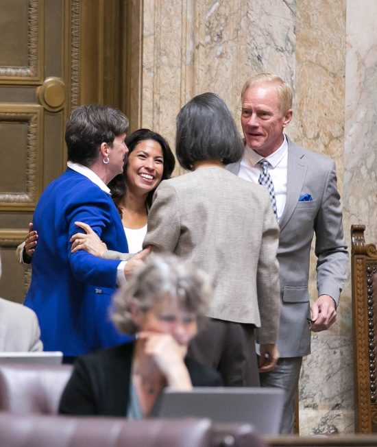 From L-R: Reps. Laurie Dolan (D-Olympia), Monica Stonier (D-Vancouver), Sharon Tomiko Santos (D-Seattle), and Paull Harris (R-Vancouver) celebrate passage of HB 2224 by the House of Representatives.