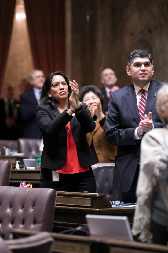 Reeves applauding on floor of the House