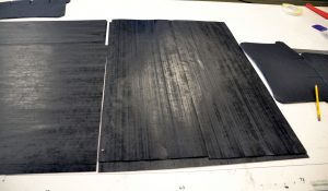 Examples of flat, uncured composite material before it's cut, molded into shape and hardened through heat and pressure. Photo by Guy Bergstrom, courtesy of the House of Representatives.