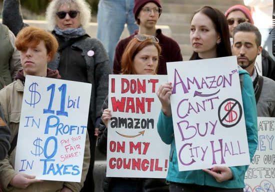 Demonstrators protest Amazon's large contributions to Seattle City Council elections.