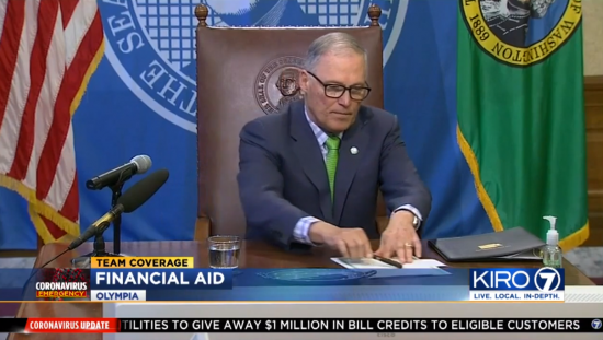 Gov. Jay Inslee signing House Bill 2965.
