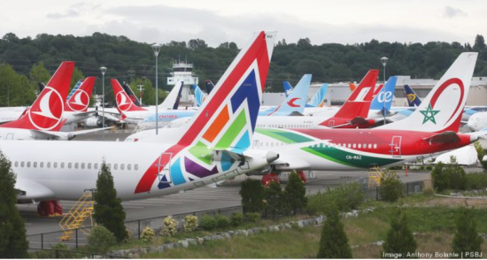 Dozens of Boeing 737s including Max 8 models, sit lined up grounded near the commercial airplane's manufacturer's facilities in Tukwila, Washington, May 20, 2020.