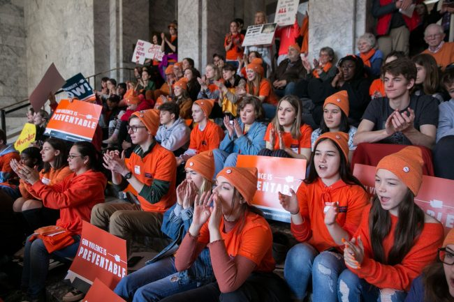 Students rally in the capital building for gun safety