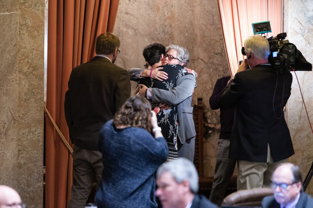 Rep. Jinkins and Rachel Smith embrace after passage of HB 1099