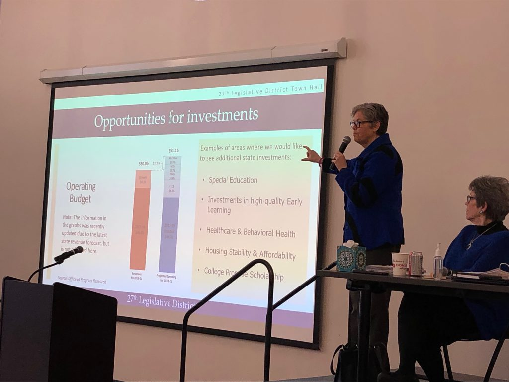 Rep. Jinkins pointing at budget slide at town hall meeting