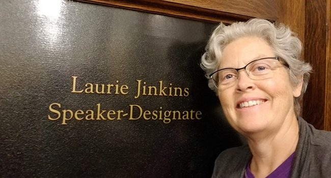 Speaker-designate Laurie Jinkins standing in front of her new office.