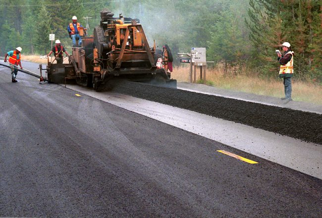 road construction crew on rural highway paving