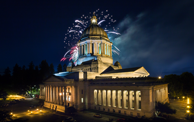 Fireworks at night over state capitol bldg