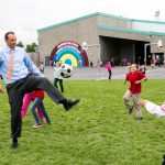 Rep. Riccelli kicking soccer ball with students