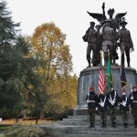 Color guard with flags at the WWI memorial on capitol campus