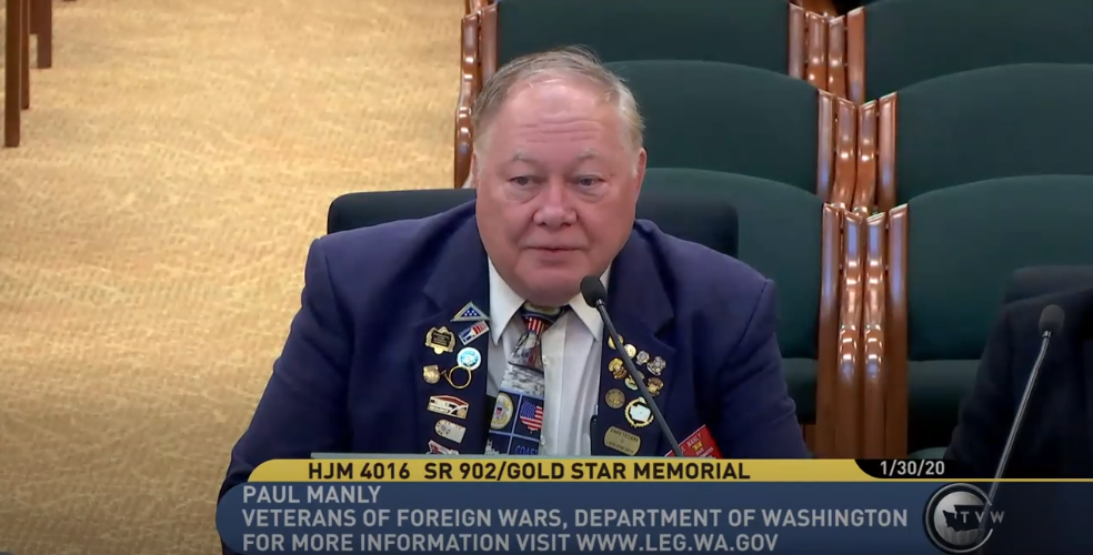 Paul Manly, state quartermaster for Veterans of Foreign Wars and bugler speaks to the committee