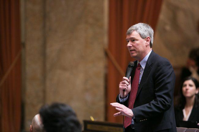 Rep. Sullivan speaking on House floor, holding mic
