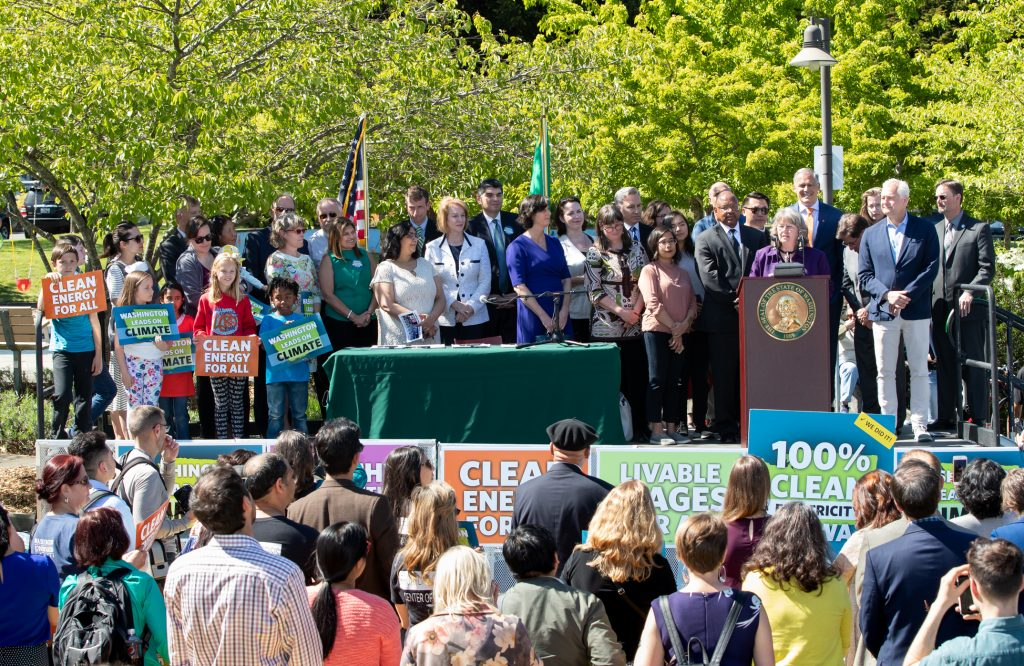 Rep. Gael Tarleton speaking at the celebration event bill signing of the 100 percent clean energy bill with Governor Inslee, Senator Reuven Carlyle, Representatives Joe Fitzgibbon, Beth Doglio, and Jake Fey