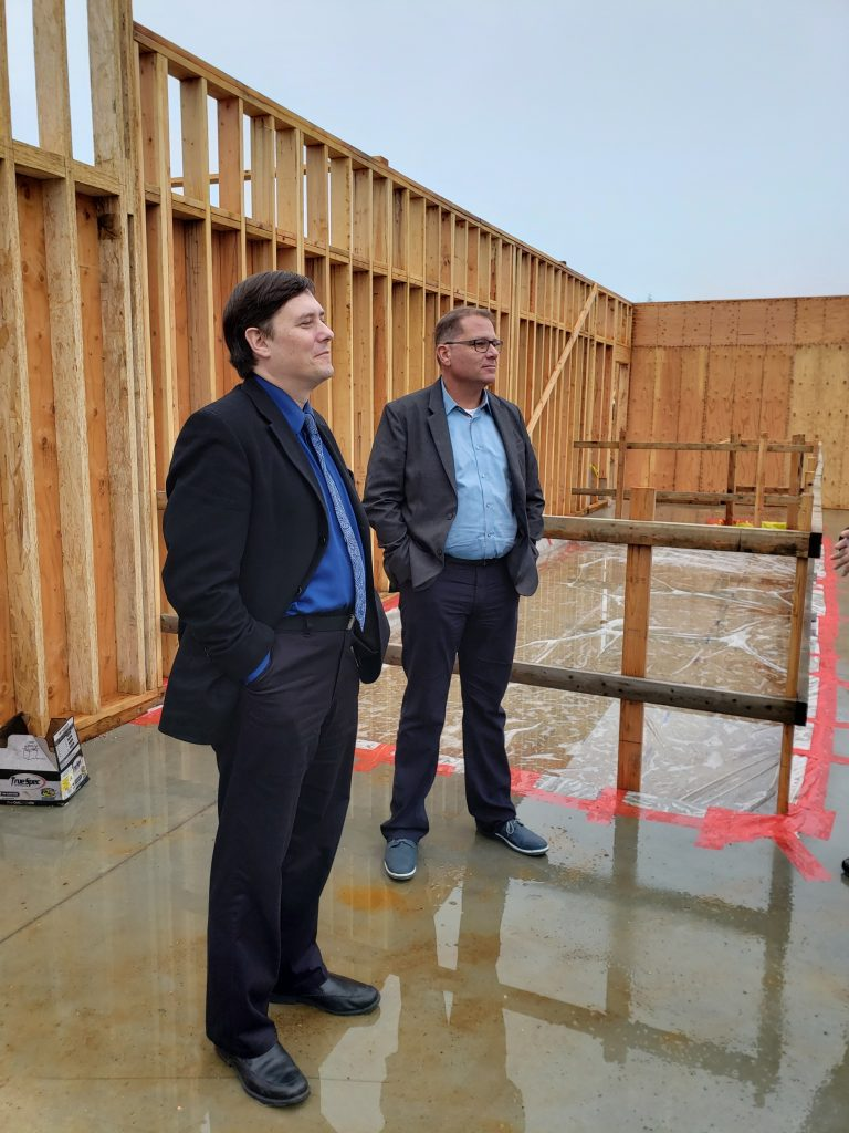 Sen. Derek Stanford (left) and Rep. Strom Peterson take a tour of the construction for The Generations Building.