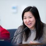 Rep. My-Linh Thai at dais with microphone