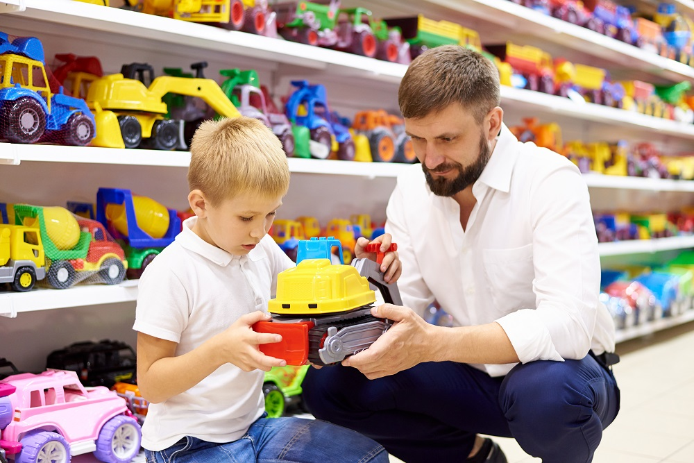 Father and son in a toy store.