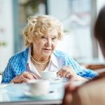 Retiree talking with friends over coffee