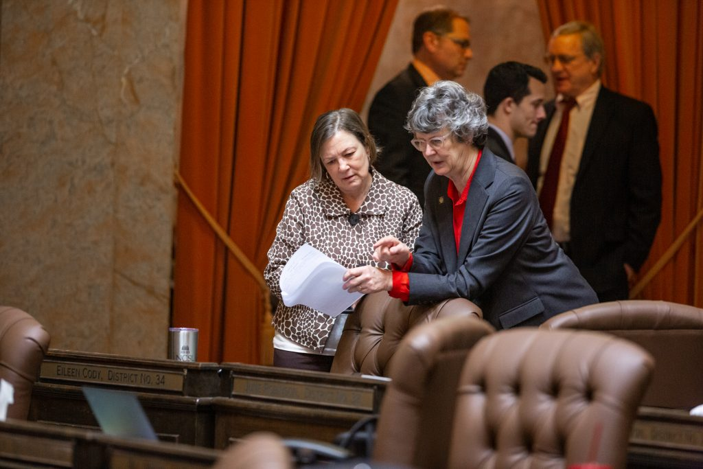 Reps. Cody and Robinson looking over legislation on the floor